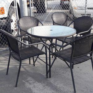 patio set 5 chairs and umbrella base good condition..set de patio for Sale in Santa Ana, CA