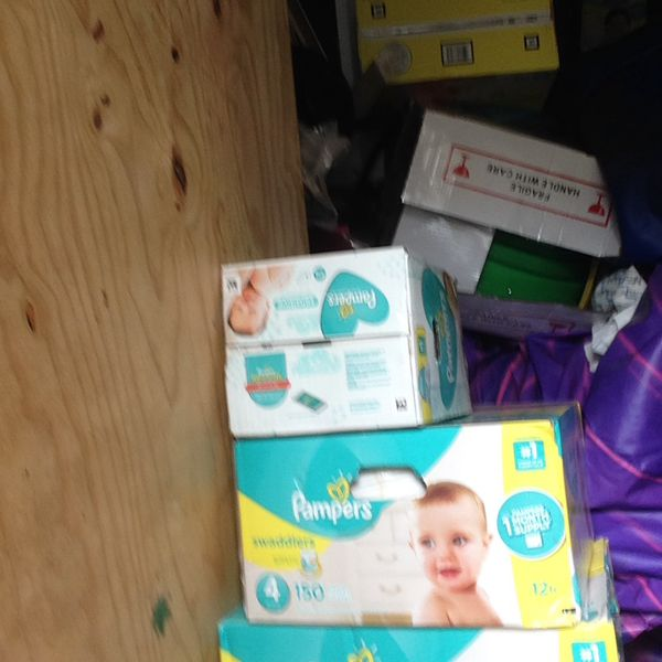 Two boxes size 4 150 count pampers and a 720 count box of wipes
