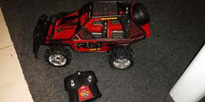Remote control red buggy car with remote good condition 8 inches tall x 15 long for Sale in Missouri City, TX