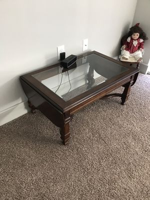 Antique coffee table with two folding leafs for Sale in Denver, CO