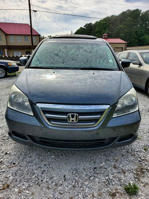 2005 Honda Odyssey E-LX Minivan, Fully loaded with Entertainment package, great leg room for family and friends. Excellent for Courier work. for Sale in Hampton, GA