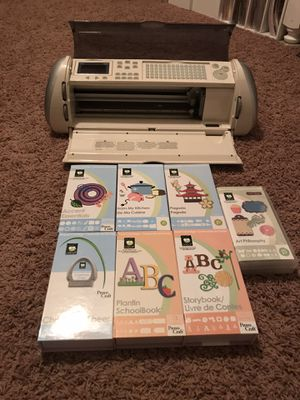 Cricut Expression with cartridges and tools for Sale in Olympia, WA