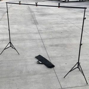 New in box max 10x7 Feet height and width Adjustable Backdrop Frame Kit Banner Stand Includes 3 Clamps and Carrying Bag for Sale in Whittier, CA