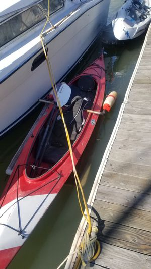 Kayak with foot controlled rudder and stabilizing pontoons. One set of double bladed paddles comes with it as well as 2 life jackets. for Sale in Benicia, CA