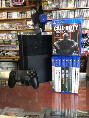 PlayStation 4 PS4 with cables, 1 controller and 9 games shown for Sale in Houston, TX