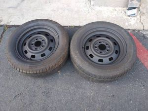 Two black steel rims and tires 5 lug Dodge, Ford, Jeep, Toyota for Sale in Montebello, CA