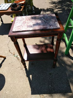 Vintage marble top table. Beautifully carved mahogany. 35. for Sale in Lubbock, TX