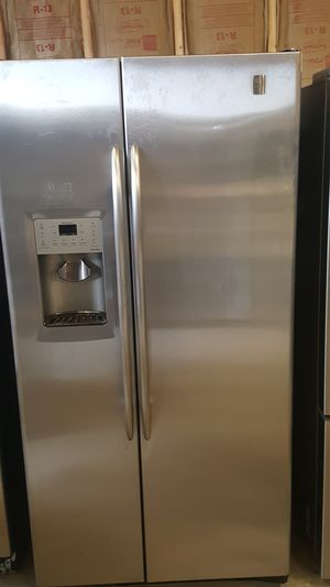 GE Stainless steel side by side refrigerator with water and ice in door Works great for Sale in Nashville, TN