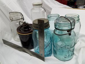 7 antique jars, 4 with blue glass, canning , cheese crock, water/juice bottle for Sale in Garden Grove, CA