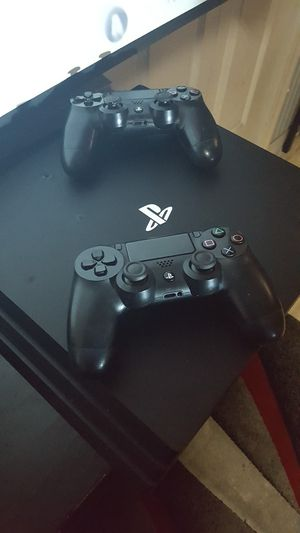 Ps4 pro 2tb jetblack 2 remotes 4 games 600 obo for Sale in Tampa, FL