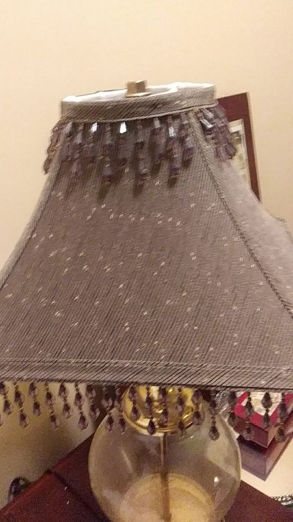 Crystal lamp with shade.