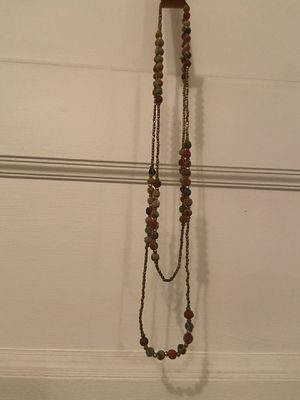 Single strand necklace with bronze and multi colored fabric beads for Sale in Denver, CO