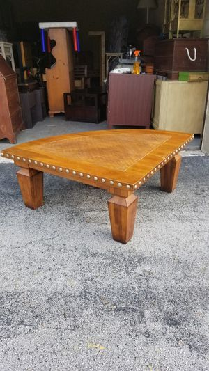 """Beautiful Solid Wood Quarter Moon Coffee Table with Brass Studded Sides that's in very good condition! Dimensions: 56""""W x 40""""D x 18""""H for Sale in Boca Raton, FL"""