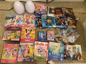 Puzzles assorted 10 brand new and 13 used and 2 memory games for Sale in Arcadia, CA