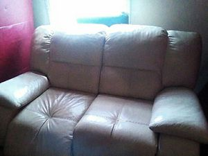 Recliner love leather couch cream 60 dollars we also have all black one with both sets for Sale in St. Louis, MO