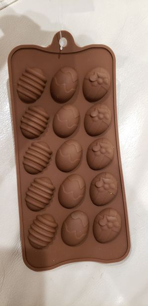 Easter eggs ice cube chocolate mold NEW Makes 15 egg shaped sweets, jello or ice cubes. Easy to get out / made of silicone for Sale in Ontario, CA