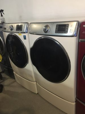 Samsung front load washer and dryer set in excellent condition with pedestal for Sale in Baltimore, MD