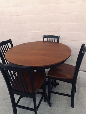 Heavy beautiful solid wood pub dining room table table and 4 bar stool chairs excellent condition l can deliver for a fee for Sale in Lodi, CA