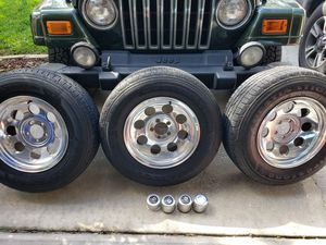 Jeep TJ 4 rims and tires for Sale in Land O Lakes, FL