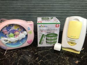 diaper refills, baby musical and projector, wipes warmer for Sale in Phoenix, AZ