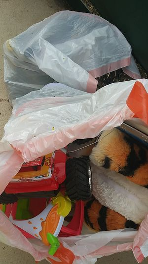 2 bags of toys and like new childrens books 2 bags for Sale in Tarpon Springs, FL