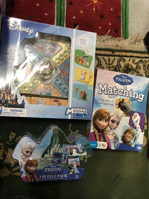 Disney Frozen games puzzles new for Sale in Jacksonville, FL