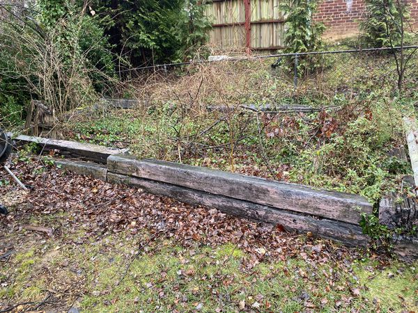 Free wood logs/ can be used for raised garden or retaining wall