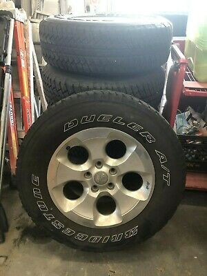 """2018 Jeep Wrangler. 18"""" OEM Rims + Brigeston Dueler A/T RHS Tires in used condition. All season Four season . Buy ASP for Sale in Westmont, IL"""