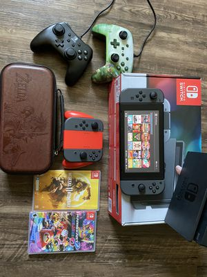 Like New Nintendo Switch Bundle 4 Joycons 2 controllers 30 games trade for PS4 for Sale in Fort Worth, TX