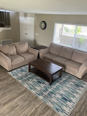 Ashley's furniture set with coffee table and end table for Sale in Anaheim, CA