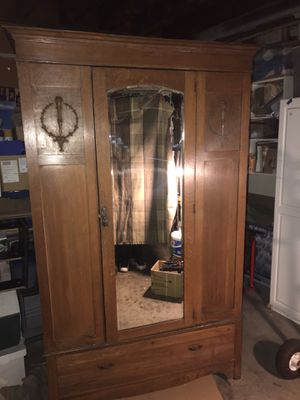 Antique armoire with beveled mirror. Approximately 78 inches tall by 48 inches wide and 24 inches deep. This comes apart into 3 separate pieces which for Sale in Montclair, CA