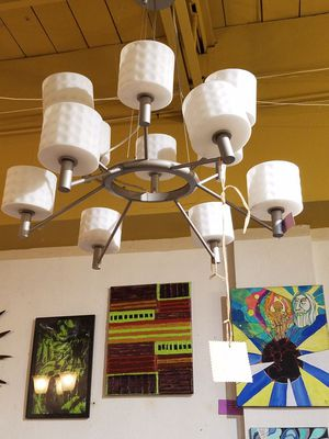 Really cool 12 light transistional Chandelier. Brushed gray w/ White glass that looks like golfballs for Sale in Dallas, TX