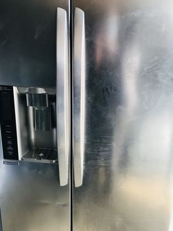 LG stainless steel side-by-side refrigerator with Water and ice maker for Sale in Auburn,  WA