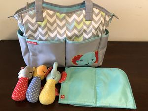 Fisher price washable large tote diaper bag, with changing pad and three soft toys. for Sale in Dublin, OH