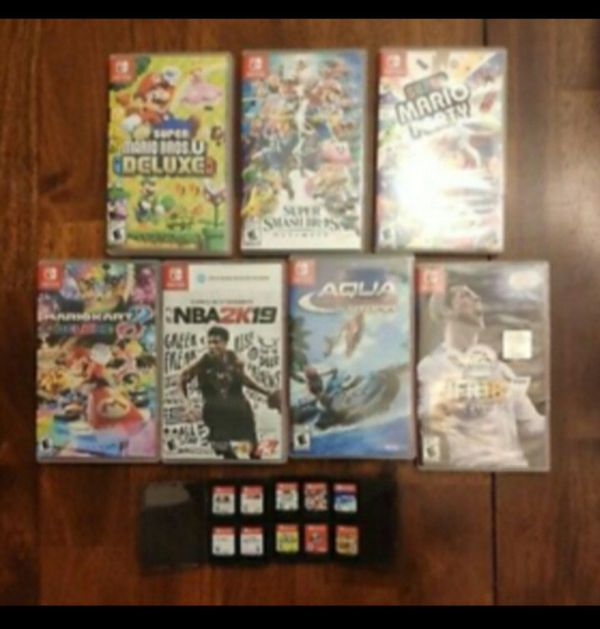 17 Nintendo switch games and preowned gray Nintendo swish console