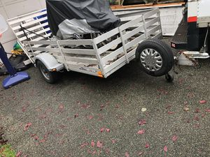 Triton aluminum trailer . 9 feet long and about 5feet wide wide bedwith motorcycle front wheels chock and tie downs hooks. Drive up ramp. for Sale in Lynnwood, WA