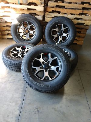 """JEEP OEM wheels 17"""" 5x5 used good condition and 95% tires price it's firm for Sale in Montclair, CA"""