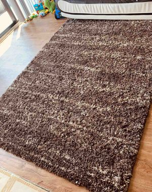 Brown area rug with one small at the same color for Sale in Alexandria, VA
