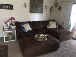 Brown Sectional plus extra large ottoman w/warranty for Sale in Laguna Beach, CA