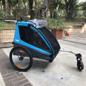 Normal wear THULE BIKE TRAILER in blue for Sale in Oak Glen, CA