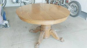 Solid Oak Antique Claw Foot Dinning Table w/ 3 extensions and two free rugs for Sale in Sun City, AZ