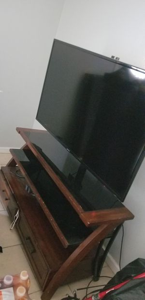 Tv size 52 inch and tv stand for Sale in Modesto, CA