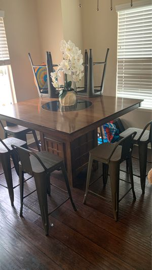 Lazy Susan dining table with 8 bar stool chairs for Sale in Brea, CA