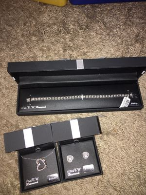 Valentine day set 1/4 carat necklace and tennis bracelet and 1/10 earrings all diamonds in sterling silver setting retail 615$ for Sale in Elk Grove, CA