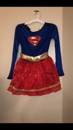BIG GIRLS SUPER GIRL COSTUME COMES WITH ORIGINAL PACKAGING SIZE (MEDIUM) for Sale in El Cajon, CA