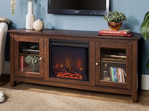 FIREPLACE TV STAND ASSEMBLED HAS MINOR CRACK ON TOP OF STAND for Sale in Fort Worth, TX