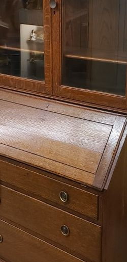Antique wood Secretary desk display cabinet dovetailed. Fold down front desk area. 2 piece for easy transport. Glass front doors for Sale in Santa Ana,  CA