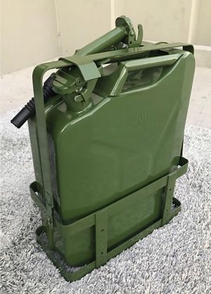 New in box 5 gallon 20 liter jerry can steel gas tank canister military green with holder included for Sale in Los Angeles, CA