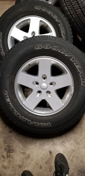 12 Jeep Wrangler wheel/tire combo for Sale in MONTGMRY, IL