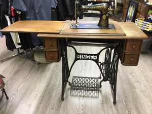 Singer sewing machine with wood table for Sale in Bristol, PA